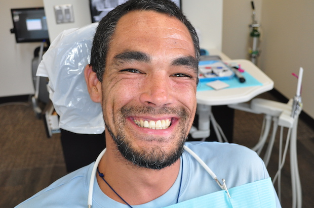 Smiling patient with dental implants
